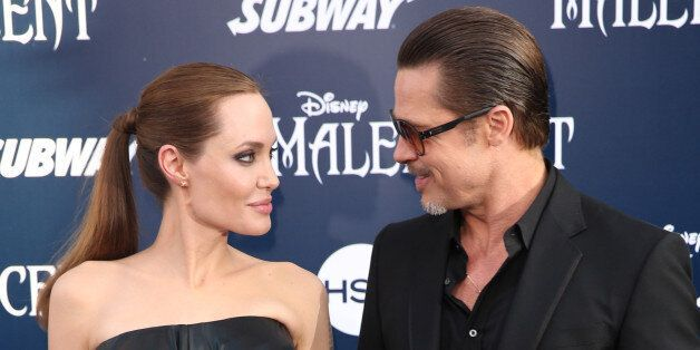 """Angelina Jolie and Brad Pitt arrive at the world premiere of """"Maleficent"""" at the El Capitan Theatre on Wednesday, May 28, 2014, in Los Angeles. (Photo by Matt Sayles/Invision/AP)"""