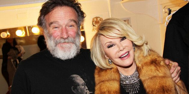 Robin Williams and Joan Rivers pose backstage at the new play 'Bengal Tiger at the Baghdad Zoo' at The Richard Rogers Theater on March 29, 2011 in New York City. (Photo by Bruce Glikas/FilmMagic)