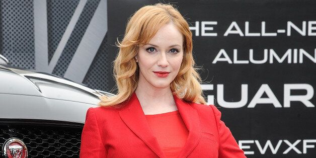 NEW YORK, NY - MARCH 31:  Actress, Christina Hendricks, poses with the all-new 2016 Jaguar XF in the Flatiron District of New