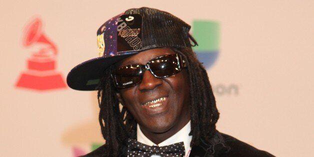 Rapper Flavor Flav arrives for the 15th Annual Latin Grammy Awards on November 20, 2014, in Las Vegas, Nevada. AFP PHOTO/JOHN