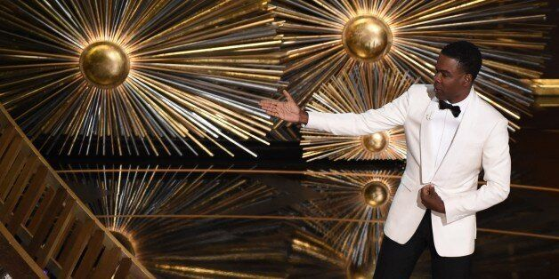Host Chris Rock speaks on stage at the 88th Oscars on February 28, 2016 in Hollywood, California. AFP PHOTO / MARK RALSTON /