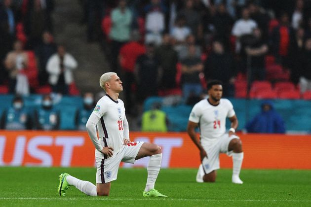 Players kneel against racism before the England v Scotland Euro 2020 match last