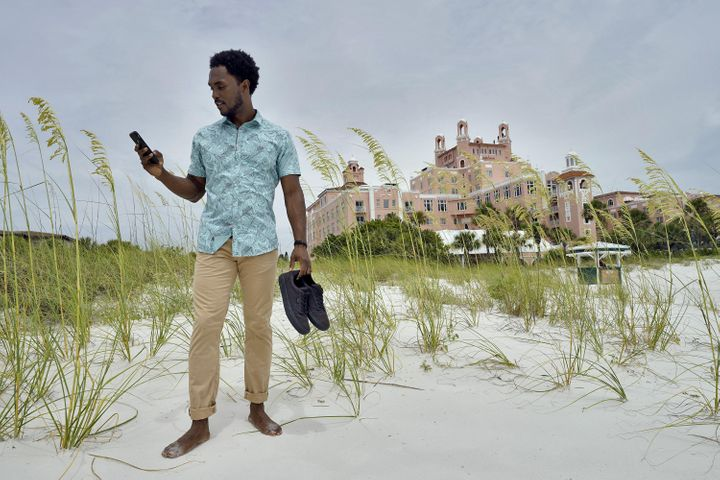 Jared Wofford poses for photos outside of the Don Cesar hotel on June 17 in St. Petersburg, FL.