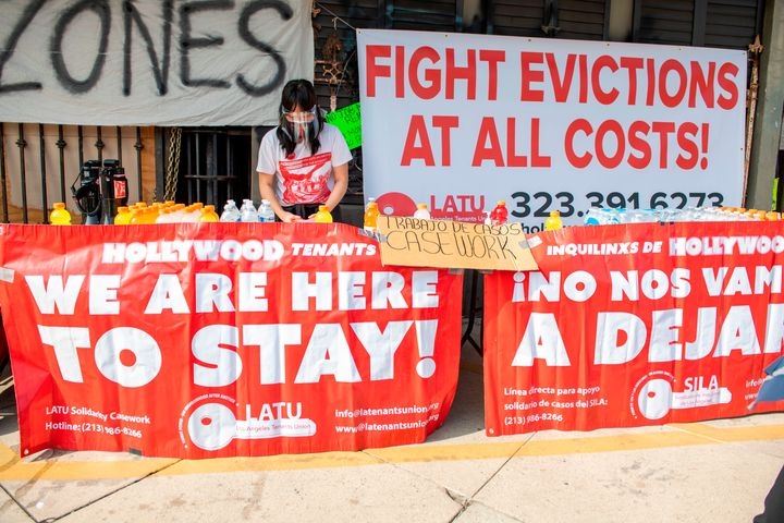 Members of the Los Angeles Tenants Union protest against evictions and give out food for homeless people in Hollywood, Califo