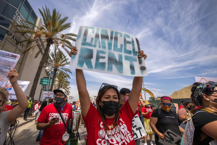A woman calls for rent relief during a march for workers and human rights in Los Angeles on May 1. California's governor has