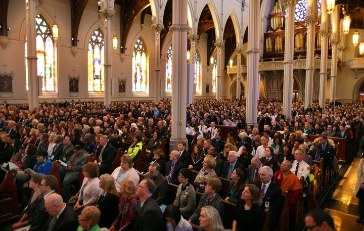 BOSTON - APRIL 18: President Barack Obama came to Boston to the Cathedral of the Holy Cross for an interfaith healing service for the victims of the Boston Marathon bombing. The audience listens. (Photo by John Tlumacki/The Boston Globe via Getty Images)