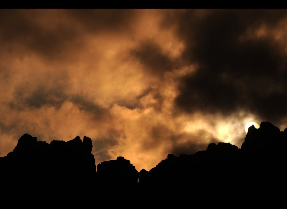 The sun rises behind a rocky crest filled with astronomical markers at the megalithic observatory of Kokino early on June 21,