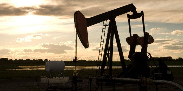 Pumping oil on the prairie at sunset. Great for industrial background.