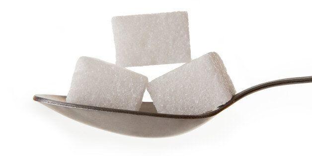 lump sugar on a spoon