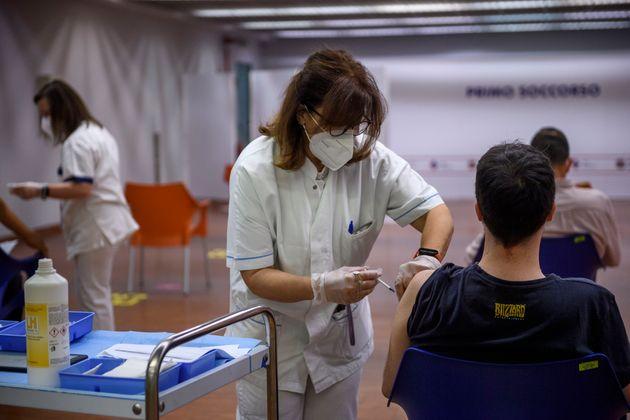 ROME, ITALY - JUNE 03: A boy receives a dose of the AstraZeneca (Vaxzevria) COVID-19 vaccine at the Vaccine...