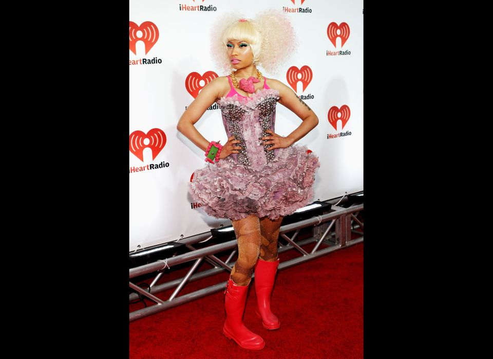 In one of her craziest accessories moments yet, Nicki wore bright red wellies and a pink plastic fried chicken necklace to th
