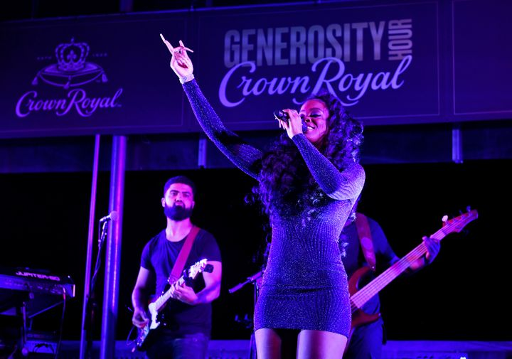R&B singer-songwriter Ari Lennox performs at the Crown Royal #GenerosityHour to give back to Washington Heights hospitali