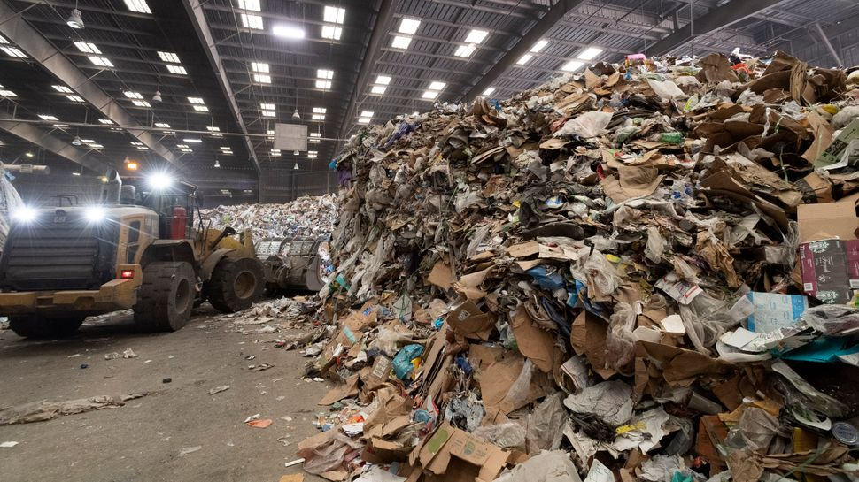 Heavy machinery moves material on the tip floor,where trucks dump their contents before waste is sorted at Republic Ser