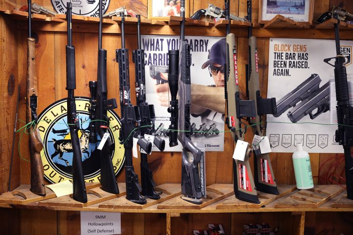Rifles are offered for sale at a store in Tinley Park, Illinois. There was a record-setting surge in gun sales last year.
