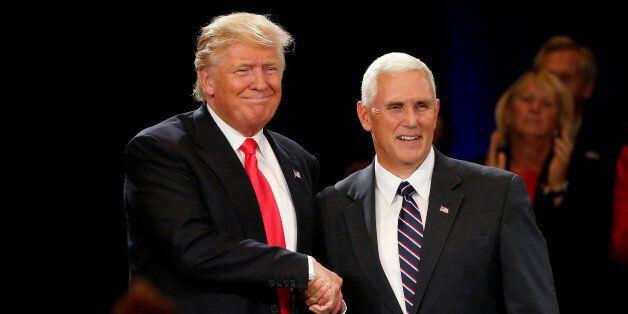 Republican presidential candidate Donald Trump (L) and vice presidential candidate Mike Pence attend a campaign event in Roan