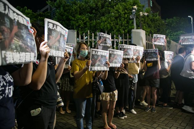 Activists and defenders of the newspaper, with the latest issue in their