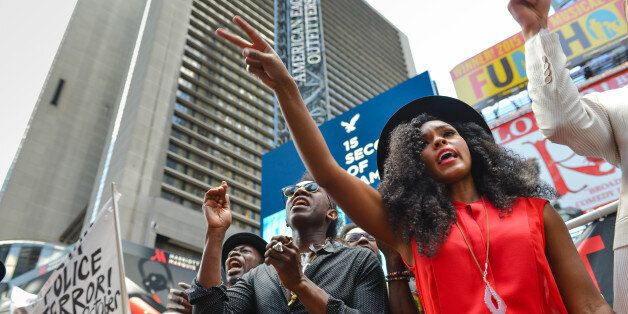 TIMES SQUARE, NEW YORK, UNITED STATES - 2015/08/13: Janelle Monae (right), a singer with Wondaland, gestures after calling ou