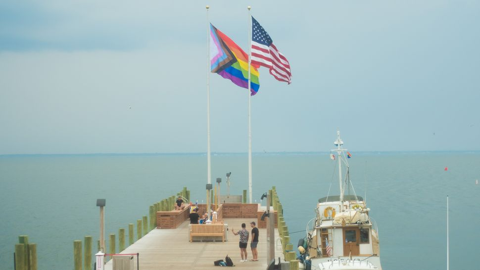 The Progress Pride Flag Raising Ceremony, part of Fire Island's inaugural Juneteenth programming, at Cherry Grove, Fire Island, New York, on June 19. The flag points to the right (representing forward progress), and sits on the left (symbolizing how there is still work to be done).