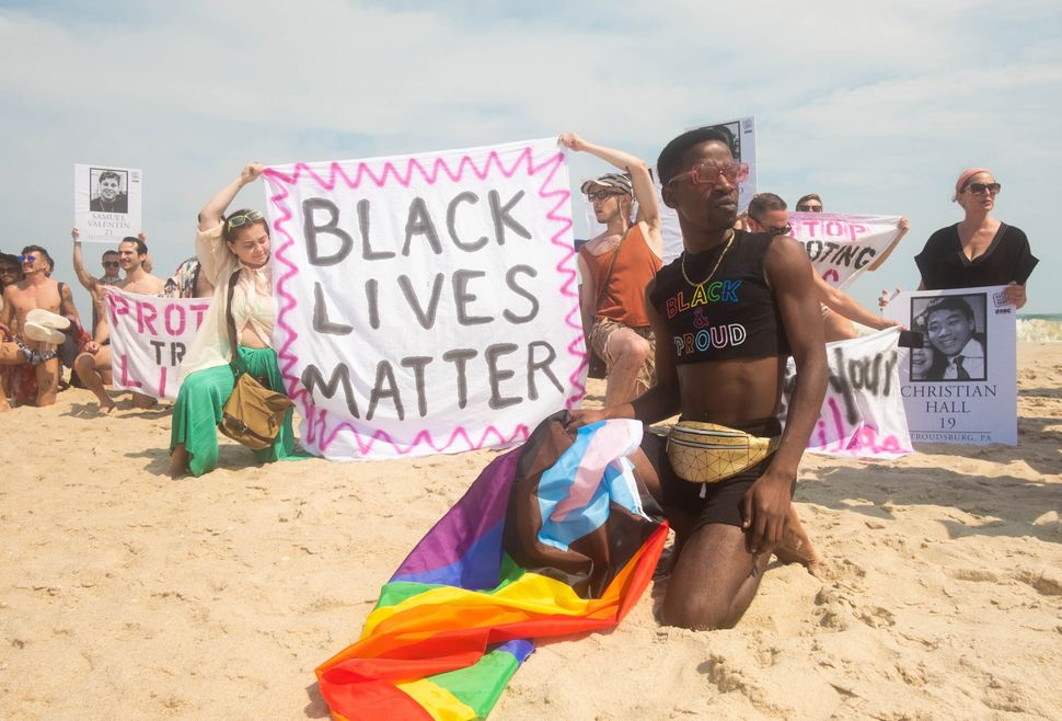 The Beach Solidarity March as part of the inaugural Juneteenth celebrations on Fire Island. Participants knelt for nine minutes and 29 seconds, the amount of time that officer Derek Chauvin kneeled on George Floyd's neck.