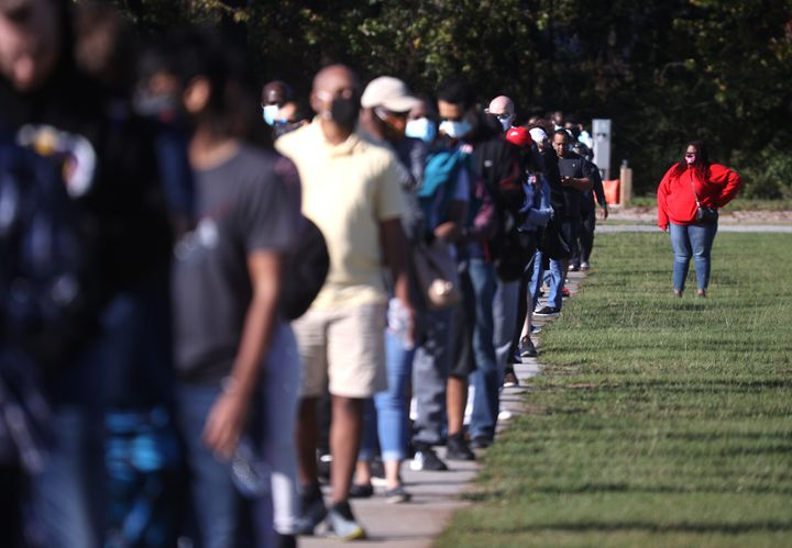 Long lines have plagued elections in states like Georgia (pictured) after hundreds of polling locations were closed following