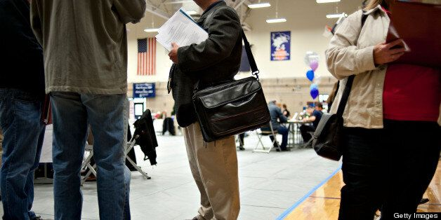 Job seekers mingle with employers during a job fair at Illinois Valley Community College (IVCC) in Oglesby, Illinois, U.S., o