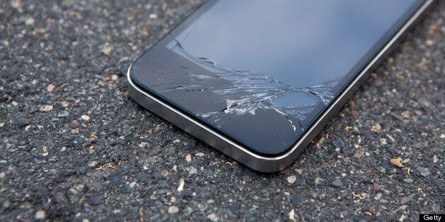 Detail of a smart phone with a cracked screen