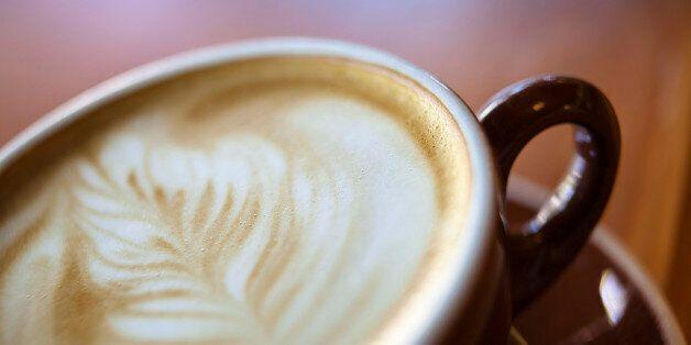 Detail shot of foam latte art in a cup of mocha.