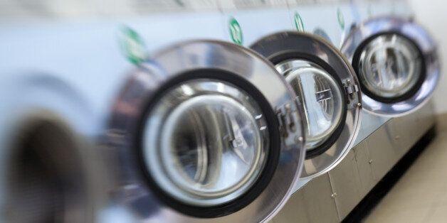 A picture taken on April 29, 2012 shows self-service laundry machines.    AFP PHOTO LOIC VENANCE        (Photo credit should
