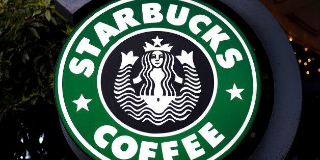 Starbucks Corp. signage hangs outside of a Starbucks coffee shop in San Francisco, California, U.S., on Tuesday, Jan. 25, 201
