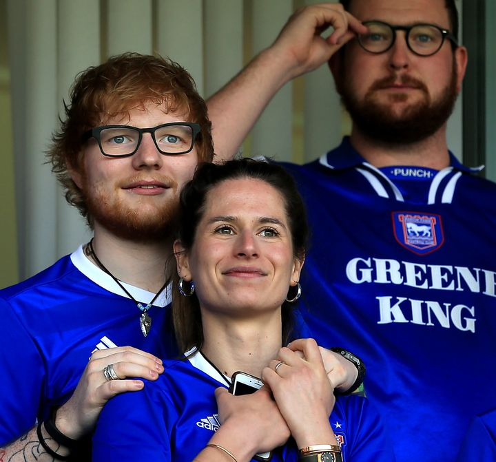 Ed Sheeran and fiance Cherry Seaborn look on during the Sky Bet Championship match between Ipswich Town and Aston Villa on April 21, 2018.