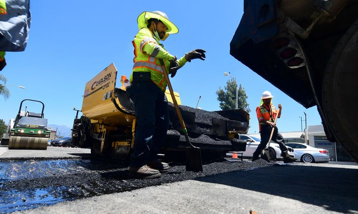A crew works on road resurfacing on June 24 in Alhambra, California.