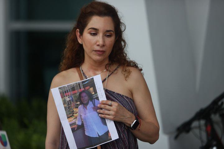 Luz Marina holds a picture of her aunt, Marina Azen, who was missing after the partial collapse of the 12-story Champlain Towers South.
