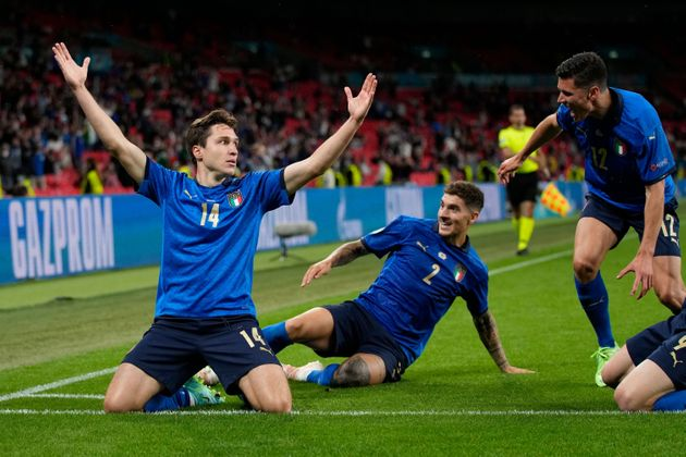 Italy's midfielder Federico Chiesa (L) celebrates after scoring the first goal during the UEFA EURO 2020...
