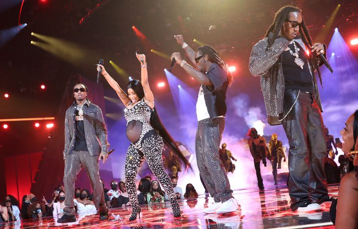 Cardi B (second from left) and (left to right) Quavo, Offset, and Takeoff of Migos perform onstage at the BET Awards 2021 at