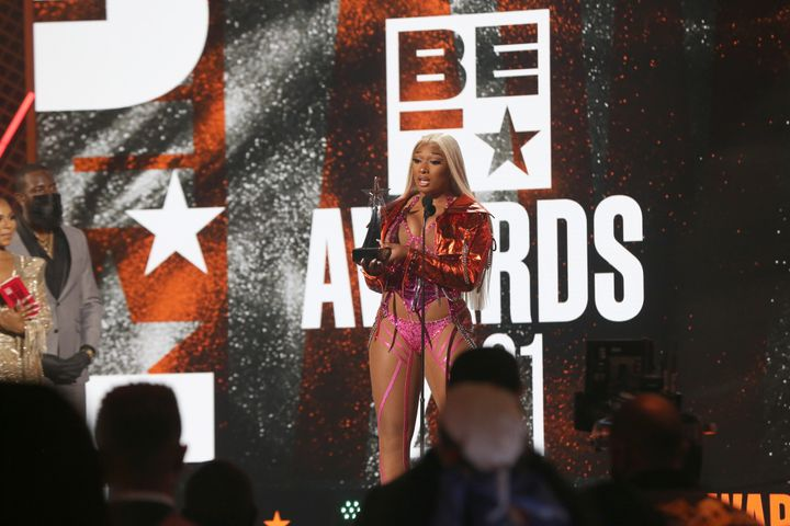Megan Thee Stallion accepts the Viewer's Choice Award onstage at the BET Awards 2021.