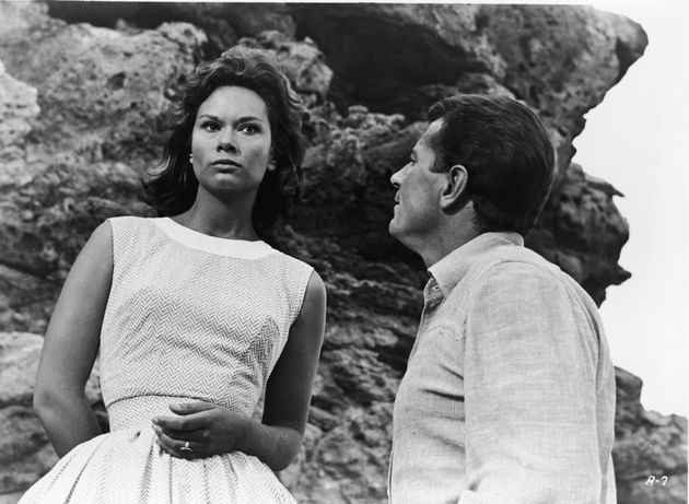 Actor Gabriele Ferzetti gazes at Lea Massari as she stares into the distance in a still from the film,...