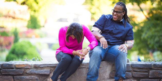 Engaged couple laughing and in love