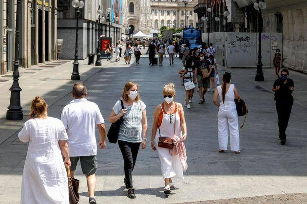 People enjoy a sunny day in downtown Milan, Italy, 27 June 2021. From 28 June all the country will be...