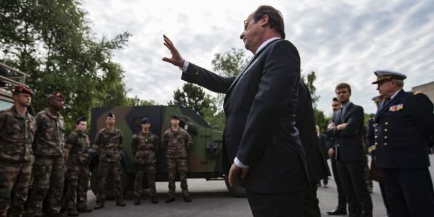 France's President Francois Hollande waves to soldiers of the anti-terror Vigipirate plan, dubbed 'Operation Sentinelle' at t