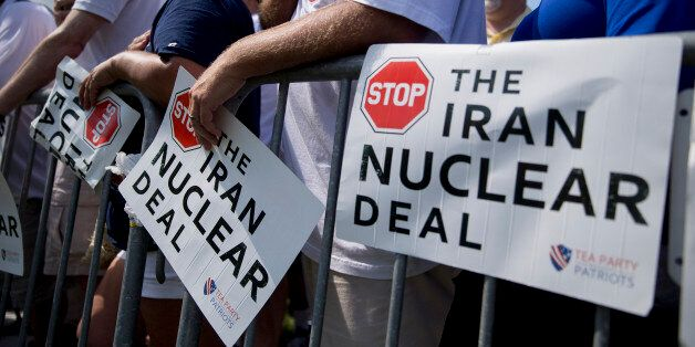 An attendee places his hands over his heart during the Pledge of Allegiance at a Tea Party Patriots rally against the Iran nuclear deal on Capitol Hill in Washington, D.C., U.S., on Wednesday, Sept. 9, 2015. A revolt among U.S. House Republicans delayed action on the Iran nuclear deal today as some members insisted they aren't bound by a Sept. 17 deadline in their efforts to kill the agreement. Photographer: Andrew Harrer/Bloomberg via Getty Images