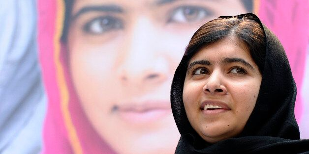 FILE - In this file photo taken Friday, Oct. 11, 2013, Malala Yousafzai, a 16-year-old girl from Pakistan who was shot in the
