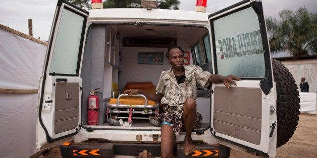 FILE - In this Wednesday, Sept. 24, 2014,  file photo, a woman suspected of suffering from  Ebola virus sits in an ambulance