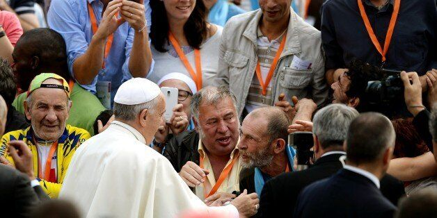 French homeless from different French cities, shake hands with Pope Francis upon his arrival for his weekly general audience