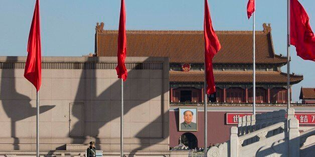 A Chinese paramilitary policeman stands on duty on Tiananmen Square near the Great Hall of the People where delegates are attending sessions of the National People's Congress and Chinese People's Political Consultative Conference in Beijing Tuesday, March 4, 2014. (AP Photo/Ng Han Guan)