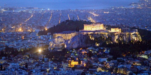 Looking out over Athens at dusk. The Aegean Sea in the background, the birthplace of modern civilization nestles in a valley