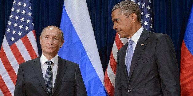 NEW YORK, NY - SEPTEMBER 28: Russian President Vladimir Putin (L) and U.S. President Barack Obama stand for the cameras befor