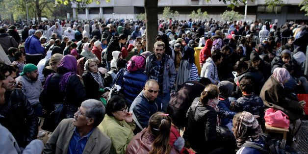 Hundreds of migrants and refugees wait for their registration at Berlin's central registration center for refugees and asylum