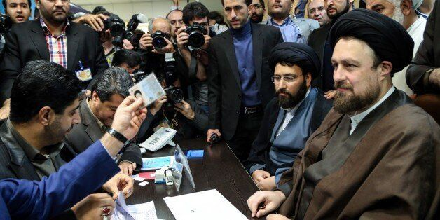 TEHRAN, IRAN - DECEMBER 18: Grandson of Iran's Ayatollah Ruhollah Khomeini, Hassan Khomeini (R) registers for February's election of the Assembly of Experts, the clerical body that chooses the supreme leader, in Tehran, Iran on December 18, 2015. The registration process for the Assembly of Experts will continue until December 23 and the registration process for those who wish to be appointed as nominees for the Parliamentary election will start on December 19. (Photo by Fatemeh Bahrami/Anadolu Agency/Getty Images)