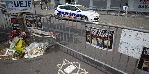 TO GO WITH AFP STORY BY SIMON VALMARY A photo taken on June 26, 2015 shows a police car parked behind metal barriers outside the Hypercacher kosher supermarket at Porte de Vincennes in Paris, six months after a bloody hostage drama at the supermarket during a jihadist attack on January 9 left four dead. AFP PHOTO / KENZO TRIBOUILLARD (Photo credit should read KENZO TRIBOUILLARD/AFP/Getty Images)
