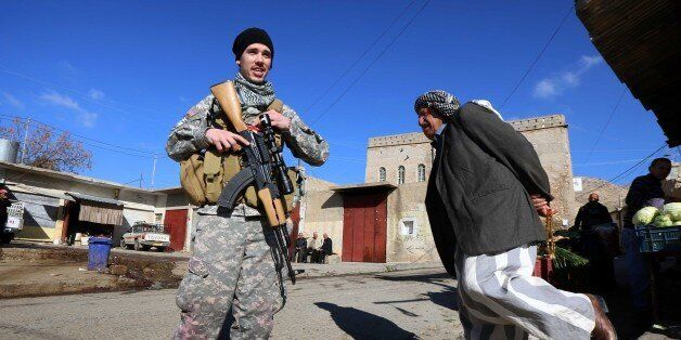 TO GO WITH AFP STORY BY JONATHAN KROHN Brett (C), a 28-year-old US national who fights jihadists of the Islamic State (IS) gr